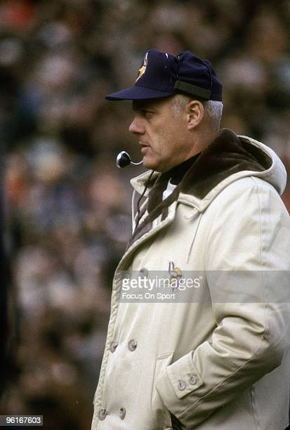 S: Head Coach Bud Grant of the Minnesota Vikings with his hands in his coat pockets watching the action from the sidelines during a late circa 1970's...
