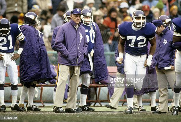 MINNEAPOLIS MN CIRCA 1970's Head Coach Bud Grant of the Minnesota Vikings with his hands in his coat pockets watching the action from the sidelines...