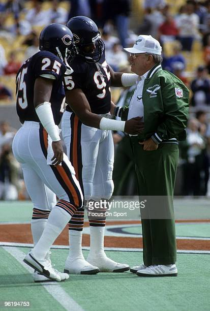 CHICAGO IL CIRCA 1980's Head Coach Buddy Ryan of the Philadelphia Eagles talking with two of his former players Richard Dent and Todd Bell of the...