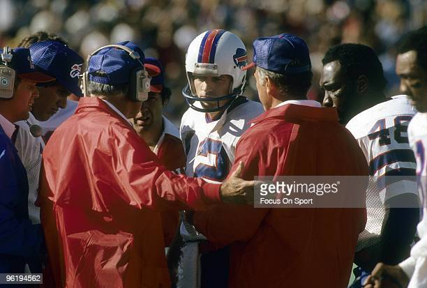 CIRCA 1980's Head Coach Chuck Knox of the Buffalo Bills talks with his quarterback Joe Ferguson on the sidelines during a early circa 1980's NFL...
