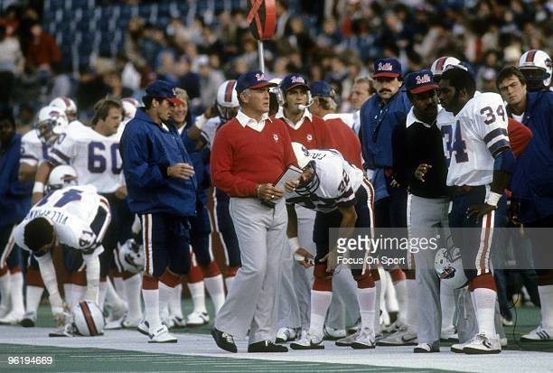 CIRCA 1980's Head Coach Chuck Knox of the Buffalo Bills with his game plan in hand walking up the sidelines during an early circa 1980's NFL football...