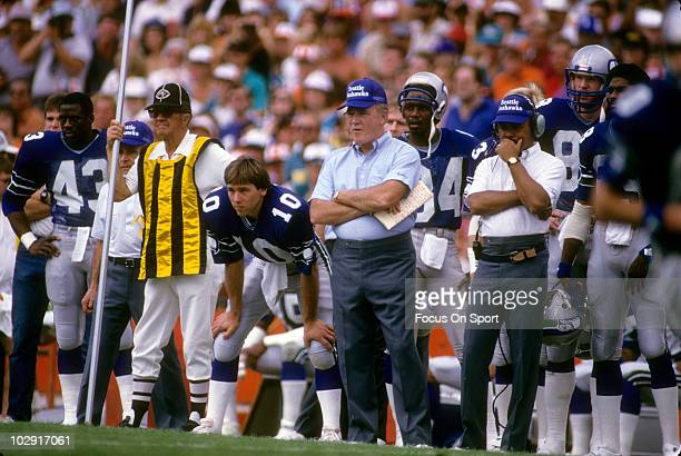 CIRCA 1980's Head Coach Chuck Knox of the Seattle Seahawks in this portrait with his arms folded standing next to quarterback Jim Zorn watching the...