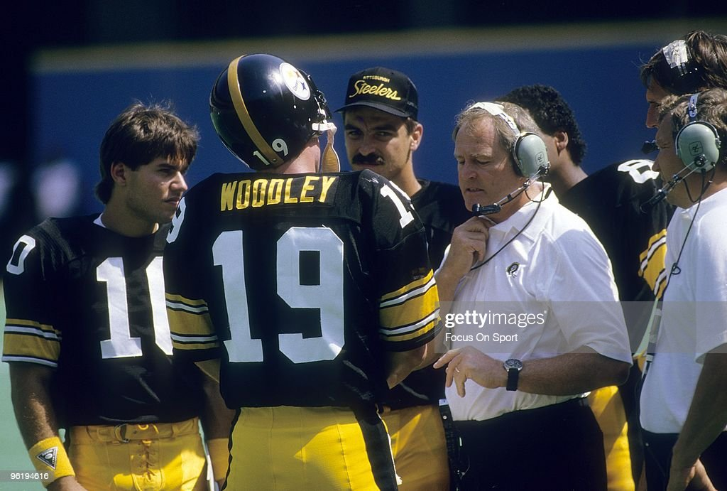 PITTSBURGH, PA - CIRCA 1980's: Head Coach Chuck Noll (R) of the Pittsburgh Steelers talking with his quarterback David Woodley #19 on the sidelines during a mid circa 1980's NFL football game at Three Rivers Stadium in Pittsburgh, Pennsylvania. Noll was the head coach of the Steelers from 1969-91.