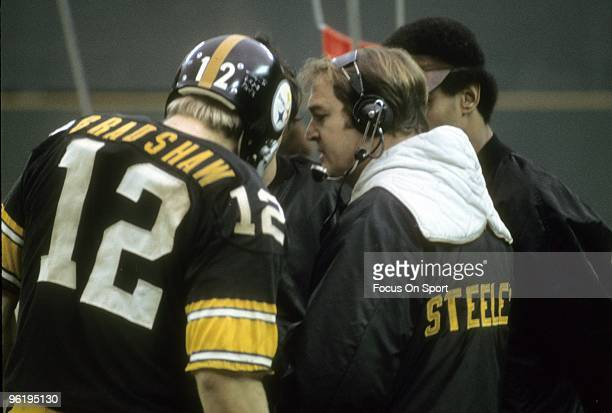 PITTSBURGH PA CIRCA 1970's Head Coach Chuck Noll of the Pittsburgh Steelers talking with his quarterback Terry Bradshaw on the sidelines during a mid...