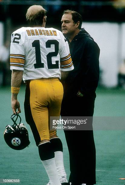 CIRCA 1970's Head Coach Chuck Noll of the Pittsburgh Steelers talks with his quarterback Terry Bracshaw on the sidelines circa late 1970's during an...