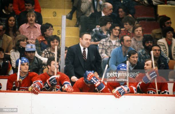 BOSTON MA 1970's Head coach Claude Ruel of the Montreal Canadiens plays behind bench against the Boston Bruins