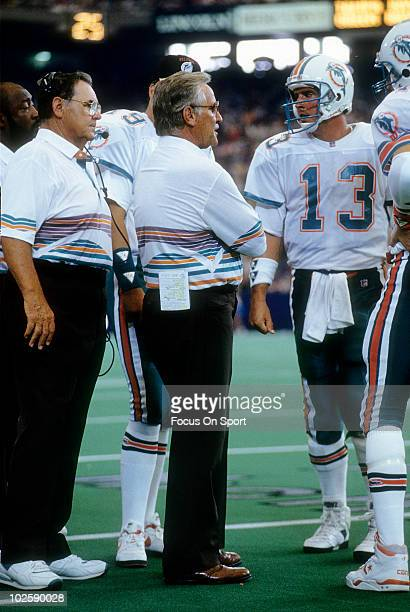 CIRCA 1990's Head Coach Don Shula of the Miami Dolphins in this portrait on the sidelines talking with quarterback Dan Marino circa early 1990's...