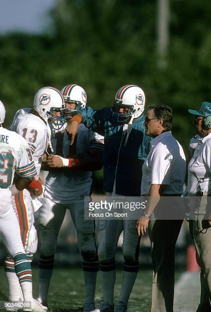 CIRCA 1980's Head Coach Don Shula talks with his quarterback Dan Marino during a time out of an NFL football game circa early 1980's Shula coached...