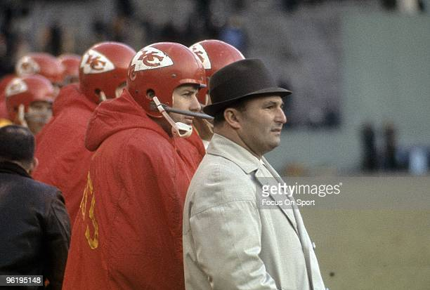 CITY MO CIRCA 1960's Head Coach Hank Stram of the Kansas City Chiefs and Quarterback Len Dawson watching the action from the sidelines during a mid...