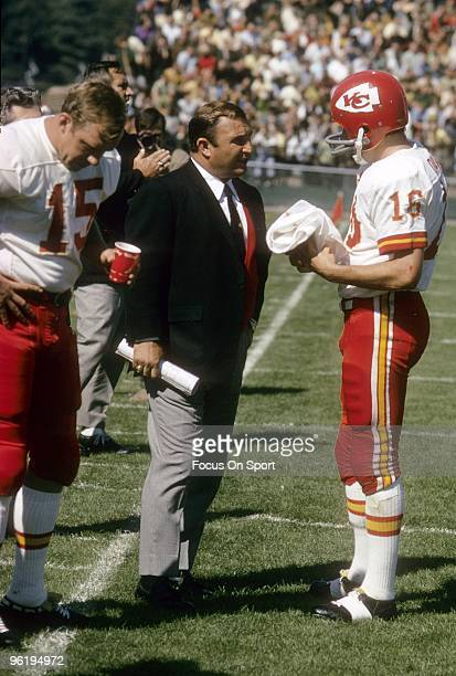 CIRCA 1960's Head Coach Hank Stram of the Kansas City Chiefs talking with his quarterback Len Dawson and Jacky Lee on the sidelines during a late...