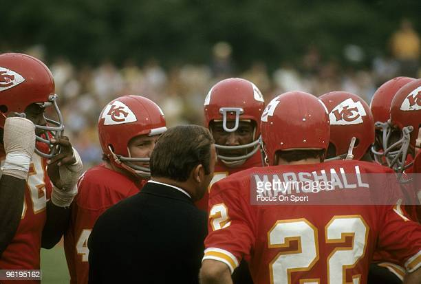 S: Head Coach Hank Stram of the Kansas City Chiefs talks with several of his players on the field during a late circa 1960's NFL football game at...