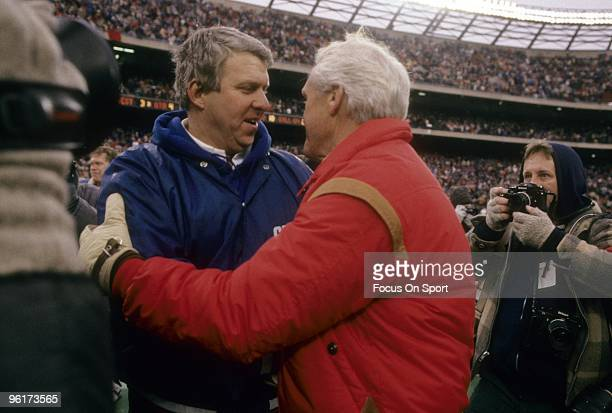 RUTHERFORD NJ CIRCA 1980's Head coach of the New York Giants Bill Parcells shakes hands with San Francisco 49ers Head Coach Bill Walsh after a mid...