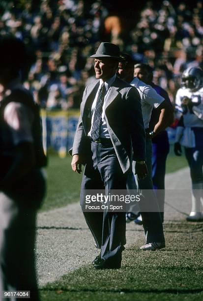 Head coach Tom Landry of the Dallas Cowboys watches the action from the sidelines during a circa 1970s NFL football game. Landry coached the Cowboys...