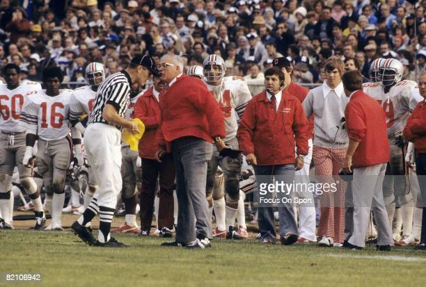 CIRCA 1970's Head Coach Woody Hayes of the Ohio State Buckeyes talks with an officia on the field mid circa 1970's during a NCAA football game Hayes...