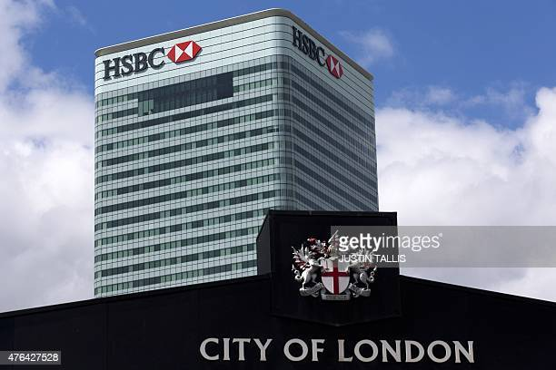 HSBC's headquarters stands beyond Billingsgate Fish Market in east London on June 9 2015 Scandalhit bank HSBC said today it would cut its global...