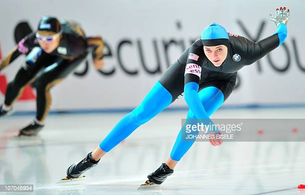 USA's Heather Richardson competes in the women's 1000m race of the ISU Speedskating World Cup on November 21 2010 in Berlin Canada's Christine...
