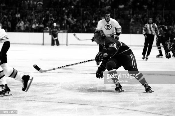 BOSTON MA 1970's Henri Richard of the Montreal Canadiens goes after the puck against the Boston Bruins