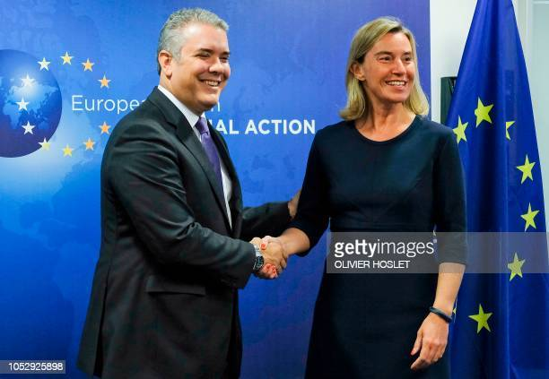 EU's High representative for foreign affairs and security policy Federica Mogherini shakes hands with Colombia's President Ivan Duque before their...