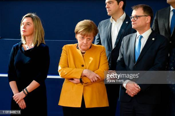 TOPSHOT EU's High representative for foreign affairs and security policy Federica Mogherini Germany's Chancellor Angela Merkel Greece's Prime...