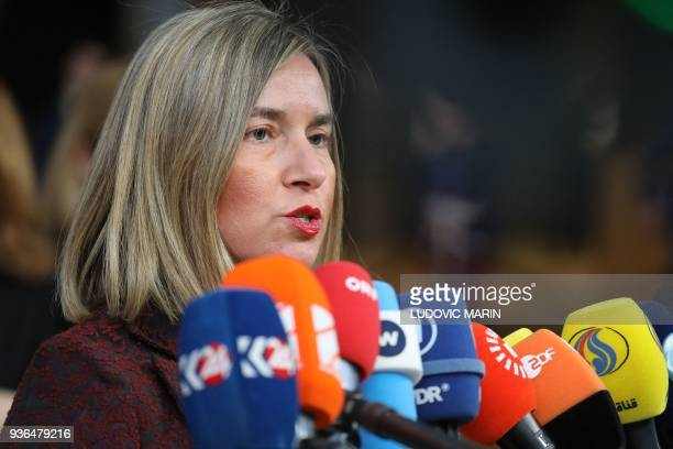 EU's High representative for foreign affairs and security policy Federica Mogherini speaks to the press as she arrives on the first day of a summit...