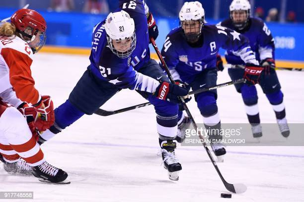 USA's Hilary Knight controls the puck in the women's preliminary round ice hockey match between the US and Olympic Athletes from Russia during the...