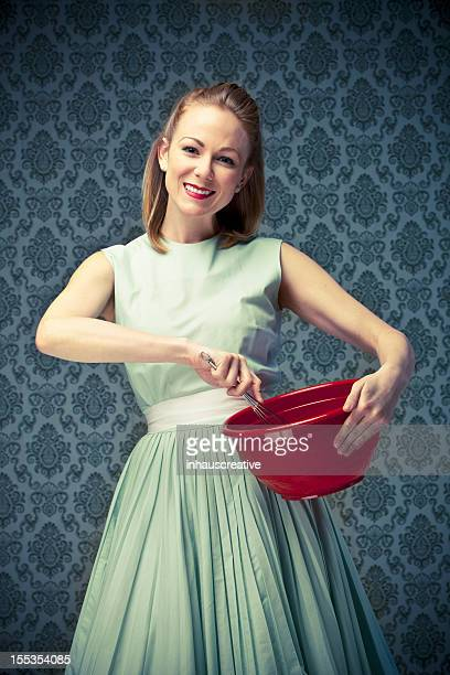 50's Housewife holding a mixing bowl