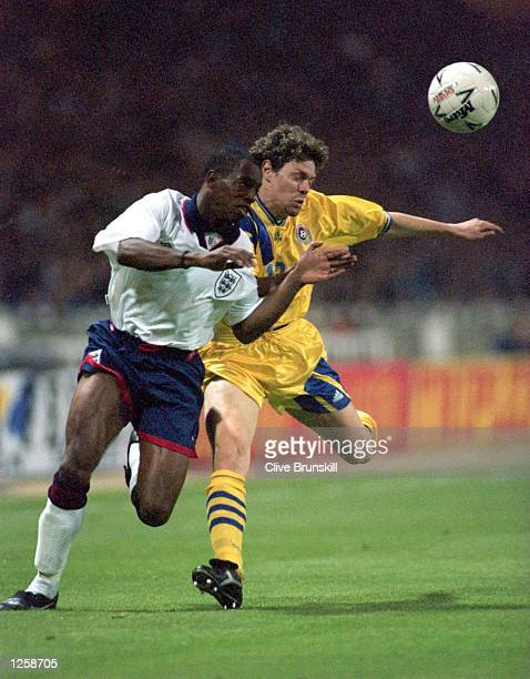 ENGLAND's IAN WRIGHT CLASHES WITH TIBOR SELYMES OF ROMANIA DURING THE ENGLAND V ROMANIA INTERNATIONAL FRIENDLY MATCH AT WEMBLEY STADIUM LONDON...