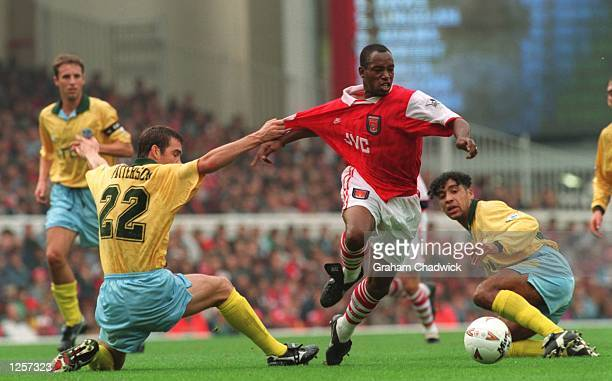 ARSENAL's IAN WRIGHT IS PULLED BY DARREN PATTERSON OF CRYSTAL PALACE DURING THE ARSENAL V CRYSTAL PALACE FA PREMIERSHIP MATCH AT THE HIGHBURY...
