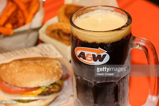 W's iconic frosted glass mug of root beer Tom Newitt Senior Dir of Marketing and Susan Senecal Chief Marketing Officer for AW Canada show off their...