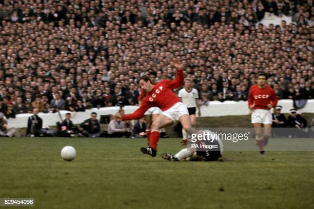 USSR's Igor Chislenko evades a tackle from West Germany's Uwe Seeler