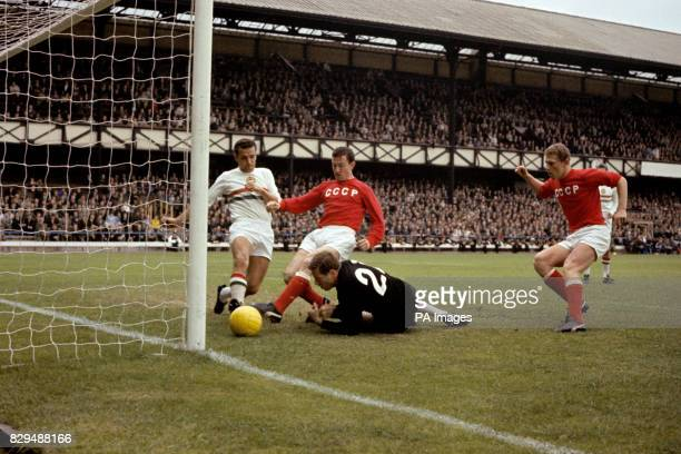 USSR's Igor Chislenko taps home the opening goal watched by teammate Anatoly Banishevski after Hungary goalkeeper Jozsef Gelei had spilled the ball...