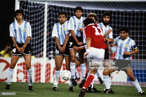 USSR's Igor Dobrovolski fires a free kick in the Argentina wall Jose Basualdo Jose Serrizuela Jorge Burruchaga Sergio Batista and Diego Maradona