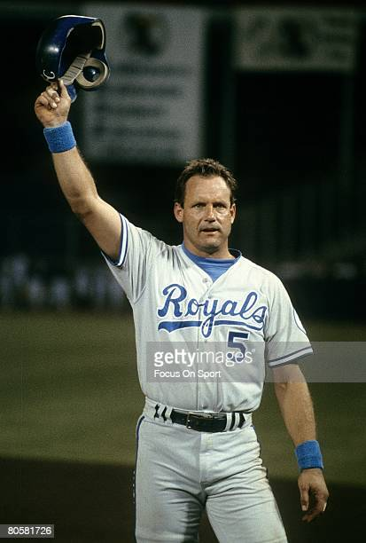 CIRCA 1990's Infielder George Brett of the Kansas City Royals tips his helmet to the crowd after a hit during a circa 1990's Major League baseball...