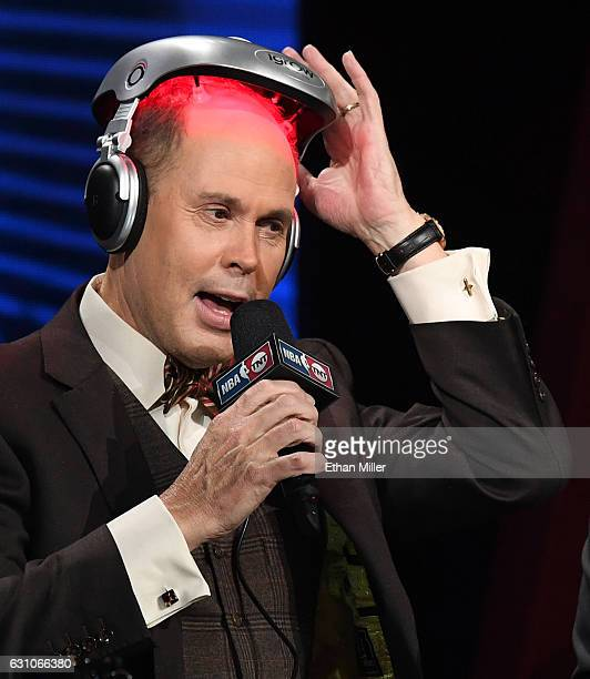 TNT's Inside the NBA host Ernie Johnson Jr puts on an iGrow laserbased hairgrowth helmet during a live telecast of 'NBA on TNT' at CES 2017 at the...