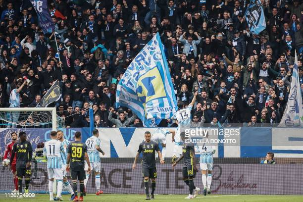 S Italian defender Kevin Bonifazi celebrates with fans after scoring an equalizer during the Italian Serie A football match SPAL 2013 vs Juventus on...