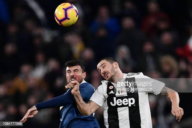 SPAL's Italian forward Andrea Petagna and Juventus' Italian defender Leonardo Bonucci go for a header during the Italian Serie A football match...