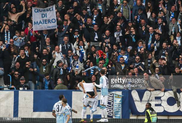 S Italian forward Sergio Floccari holds his shorts as he celebrates with fans after scoring during the Italian Serie A football match SPAL 2013 vs...