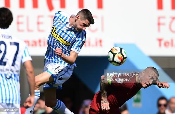 S Italian midfielder Federico Mattiello vies for the ball with Roma's Belgian midfielder Radja Nainggolan during the Italian Serie A football match...