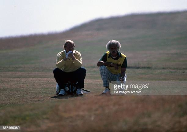 USA's Jack Nicklaus sits with his caddie waiting to play his shot