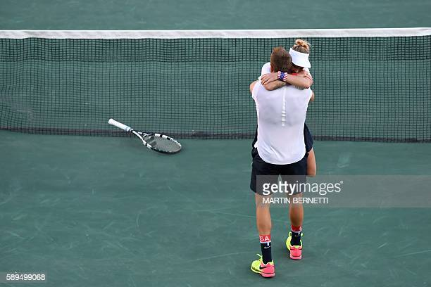USA's Jack Sock and USA's Bethanie MattekSands celebrate after beating USA's Venus Williams and USA's Rajeev Ram in their mixed doubles gold medal...