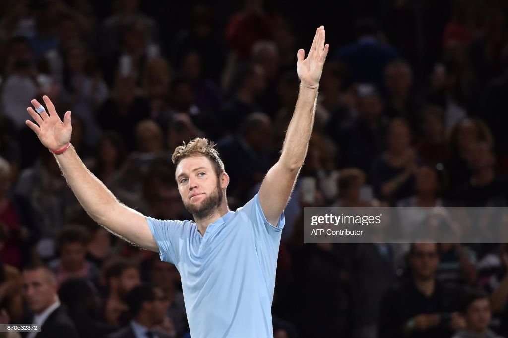 TOPSHOT - USA's Jack Sock celebrates winning against Serbia's Filip Krajinovic during the final of the ATP World Tour Masters 1000 indoor tennis tournament on November 5, 2017 in Paris. Sock won the match 5-7, 6-4 and 6-1. /