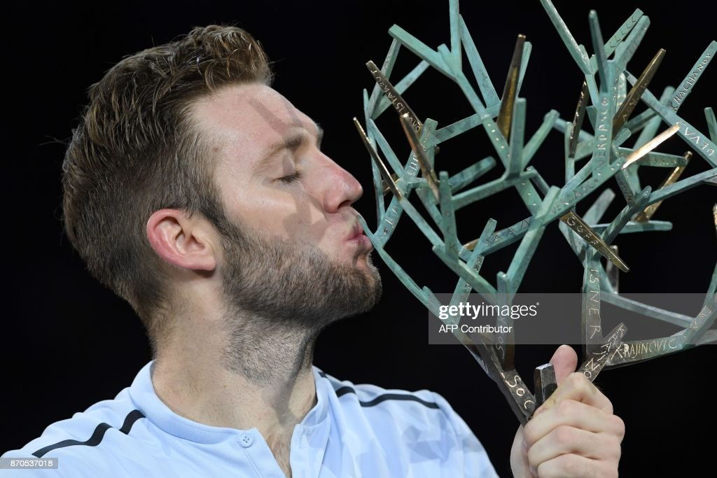 TOPSHOT - USA's Jack Sock kisses the trophy after winning against Serbia's Filip Krajinovic during the final of the ATP World Tour Masters 1000 indoor tennis tournament on November 5, 2017 in Paris. Sock won the match 5-7, 6-4 and 6-1. /