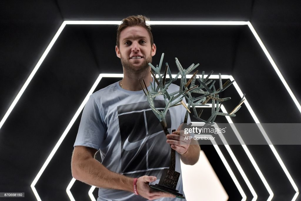 USA's Jack Sock poses with the trophy after winning against Serbia's Filip Krajinovic during the final of the ATP World Tour Masters 1000 indoor tennis tournament on November 5, 2017 in Paris. /