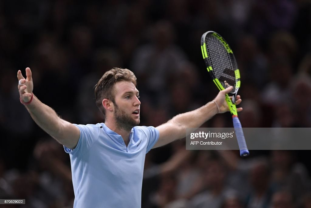 USA's Jack Sock reacts as he plays against Serbia's Filip Krajinovic during the final of the ATP World Tour Masters 1000 indoor tennis tournament on November 5, 2017 in Paris. Sock won the match 5-7, 6-4 and 6-1. /