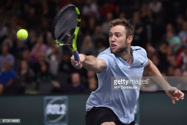 USA's Jack Sock returns the ball to Serbia's Filip Krajinovic during the final of the ATP World Tour Masters 1000 indoor tennis tournament on...
