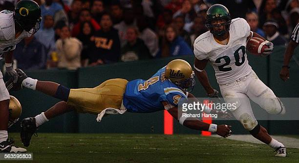 UCLA's Jarrad Page gets horizontal as he dives but he can't catch Oregon tailback Kenny Washington right during 2nd quarter action against Oregon...