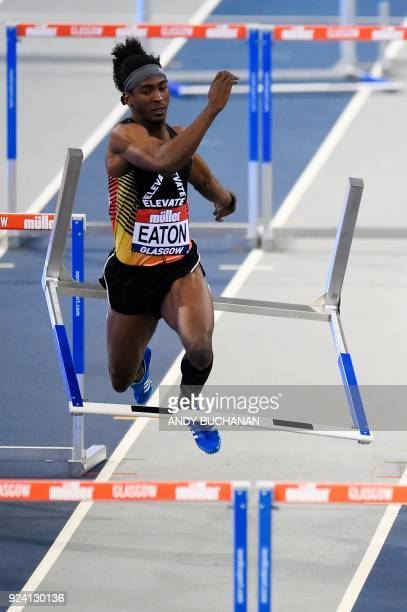 USA's Jarret Eaton falls as he competes in the men's 60metres hurdles final at the Glasgow Indoor Grand Prix athletics competition at the Emirates...