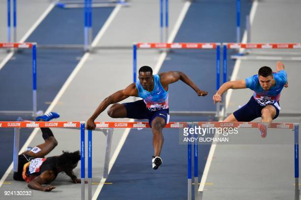 USA's Jarret Eaton falls as Jamaica's Ronald Levy heads to victory ahead of Britain's Andrew Pozzi in the men's 60metres hurdles final at the Glasgow...
