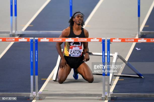 USA's Jarret Eaton reacts after falling in the men's 60metres hurdles final at the Glasgow Indoor Grand Prix athletics competition at the Emirates...