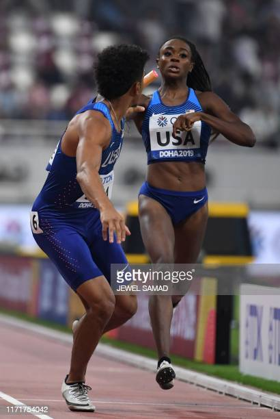 USA's Jasmine Blocker passes the baton to USA's Obi Ibgokwe in the Mixed 4 x 400m Relay heats at the 2019 IAAF World Athletics Championships at the...